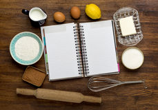 Blank recipe book with ingredients on rustic Stock Images