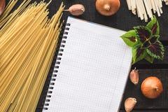 The blank recipe book with italian spaghetti Royalty Free Stock Photo