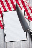 Blank recipe book with kitchen knife Royalty Free Stock Images