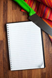Blank recipe book and kitchen knife Stock Image