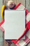 Blank recipe book. With kitchen towel on wooden background Royalty Free Stock Image