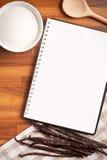 Blank recipe book and vanilla pods Stock Photos
