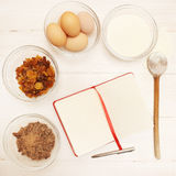 Blank recipe book. With various ingredients on the wooden table Stock Photos