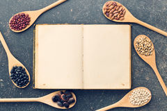 Blank recipe book and various legumes Stock Images