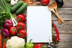 Recipe book with vegetables royalty free stock photography