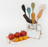 Blank Recipe Card, Flour Sifter with Wooden Spoons, Fresh Tomatoes Kitchen Scene. Kitchen scene with blank recipe card, flour sifter with wooden spoons, fresh Stock Photography