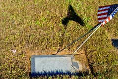Blank gravestone with American Flag stock image