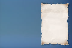 Blank recycled paper on blue background. stock illustration