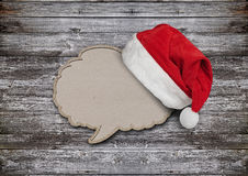Blank recycled paper speech bubble with Santa hat Royalty Free Stock Photos