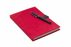 Blank red hardcover notebook with pen Royalty Free Stock Images