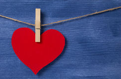 Blank red heart over wood wall Stock Images