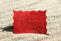 Blank Red Message Note Card in Sand Stock Photo
