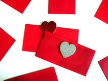 Blank red packet with hearts. Chinese new year festival decorations, blank red packet or ang pow ready for text. St. Valentine`s Day. Red and silver glitter royalty free stock image