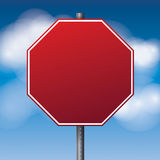 Blank Red Road Stop Sign Illustration. A realistic red road stop sign over a blue clouded sky illustration. Room for copy. Vector EPS 10 available Royalty Free Stock Images
