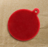 Blank red round badge. On paper background royalty free stock photography