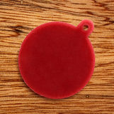 Blank red round badge. On wooden background stock photography