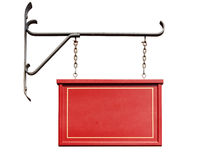 Blank red shop sign with iron wall mount isolated Royalty Free Stock Photo