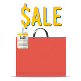 Blank red shopping bag with paper price tag. Royalty Free Stock Photography