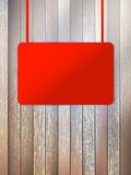 Blank red signboard on aged wooden wall. EPS10 Stock Photos