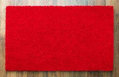 Blank Red Welcome Mat On Wood Floor Background Ready For Your Text. Blank Red Welcome Mat On Wood Floor Background Ready For Your Own Text stock image