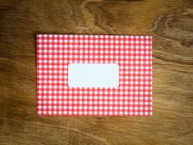 Blank red an white checked windowed envelope Stock Photo