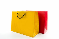 Blank red and yellow paper shopping bag. Stock Images