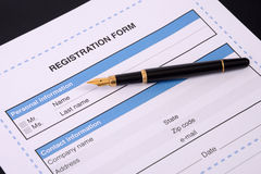 Blank registration form. Blank registration form with a black pen Stock Images