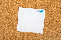 Blank Reminder Note as Copy Space. Blank Paper Reminder Note Pinned to a Cork Memory Bulletin Board as Copy Space for Your Message stock image