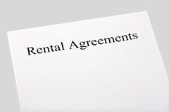 Blank rental agreements. Isolated on gray background Royalty Free Stock Images