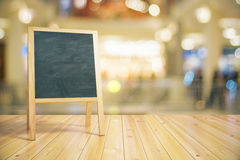 Blank restaurant blackboard on wooden floor Royalty Free Stock Photo