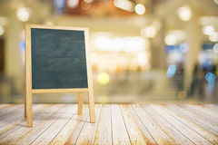 Blank restaurant blackboard on wooden floor Royalty Free Stock Images