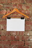 Blank retail sign hanging on coat hanger Royalty Free Stock Photos