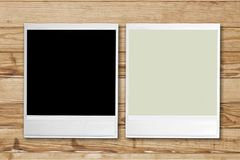 Blank retro photo frames on wooden background. Photo retro blank frames color image background royalty free stock photo