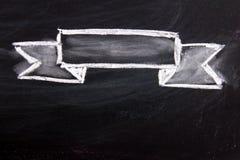 Blank ribbon draw by white chalk on black board. Background Stock Photo