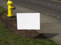 Blank Road Sign. A blank white sign on the side of the road Royalty Free Stock Images