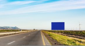 Blank road sign on highway. Traffic sign on road.  Blank billboard Royalty Free Stock Photo