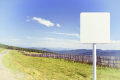 Blank Road Sign on Mountain Road Stock Images