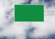 Blank road sign. Over cloudy sky Royalty Free Stock Photos