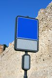 Blank road sign with a place for a picture or text. Blank and isolated road sign (blue&white) against brick wall with a place for a picture or text. Clipping stock image