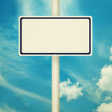 Blank road sign. S, empty street post, blue sky background in vintage style Royalty Free Stock Photography