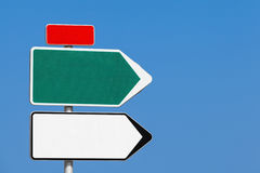Blank road sign. White and green arrows, red label Stock Image