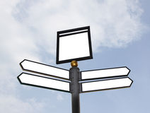 Blank road signs. A road sign pointing at several directions with sky as the background, clipping paths included for signs stock photo