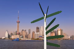 Blank road signs, Shanghai skyline Stock Photo