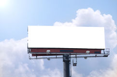 Blank roadside billboard on bright sunny blue sky day Royalty Free Stock Photography