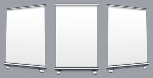 Blank roll up banner display. On gray background Royalty Free Stock Images