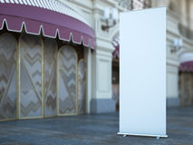 Blank roll up banner near old building. 3d rendering Royalty Free Stock Image