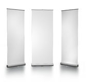 Blank roll-up posters. Three blank roll-up posters on white background Stock Photography