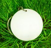 Blank round badge in green grass stock images