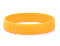 Blank rubber plastic stretch yellow bracelet isolated on white b royalty free stock photos