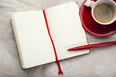 Blank ruled notebook and espresso on table Royalty Free Stock Image